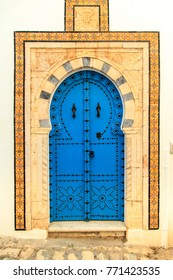 Traditional blue door with ornament in Sidi Bou Said, Tunisia.