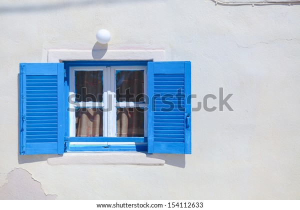 Traditional blue greek style windows in Emporio town, Santorini
