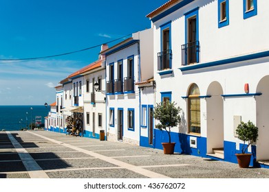 Traditional blue and white Alentejo Portuguese buildings in Porto Covo, Portugal