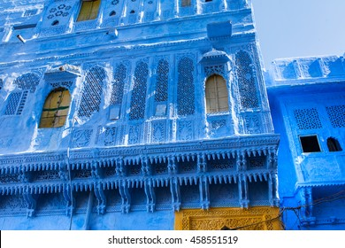 Traditional blue windows and wall in Blue City Jodhpur, India.