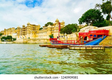 Traditional boat in front of City Palace complex, Udaipur, Rajasthan, India