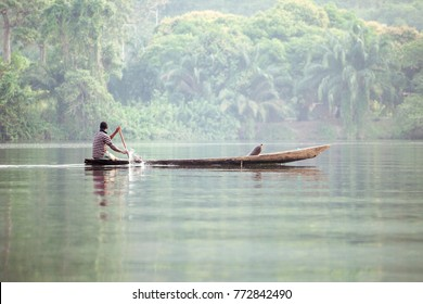 Traditional Boat on Tropical River Volta in Ghana, West Africa.