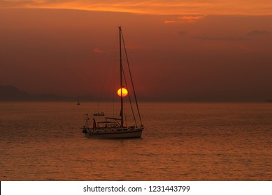 Traditional boat at sunset in Corfu island, Greece