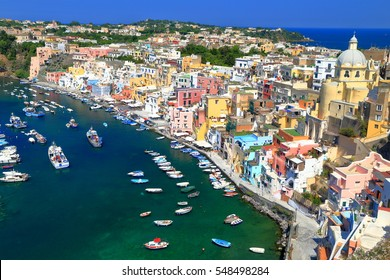 Traditional boats inside Marina Corricella on the island of Procida, bay of Naples, southern Italy