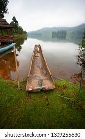 Traditional boats at Lake Bunyonyi in Uganda, Africa, at the borders of Uganda, Congo Democratic Republic and Rwanda, not far from the Bwindi National Park, home of the last mountain gorillas