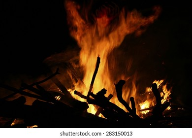traditional bonfire of San Juan, witch figure out the flames,  traditional bonfire on the  Riazor beach and others towns of Galicia, Spanish festivals and tourist attractions, eating, fun,spring,