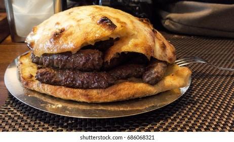 Traditional Bosnian meatball cevapcici, Travnik, Bosnia and Herzegovina