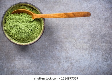 Traditional bowl with green Matcha tea powder. Top view, copy space.