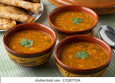 Traditional bowl of Moroccan harira close up and filled Msemmen for iftar in ramadan