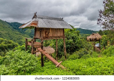 Traditional Boyhood Raised Hillside Hut in Indigenous Ethnic Minority Akha Hill Tribe Village in Northern Laos. (Nam Ha Protected Area, Luang Namtha, Laos).