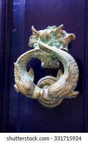 The traditional Brass Maltese Door knocker features a dolphin or in this case a pair of kissing Dolphins