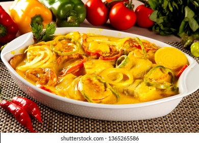 Traditional Brazilian dish called Moqueca de peixe. Cod Fish on white bowl.