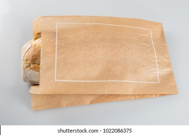 traditional bread in brown kraft paper wrapper ready receive your brand logo