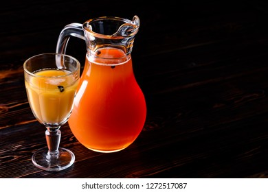traditional bread kvass, Traditional Russian cold rye drink Kvas in a glass and a jug on the kitchen table in a rustic style. Kvass from bread, rye malt, sugar and water. Copy space