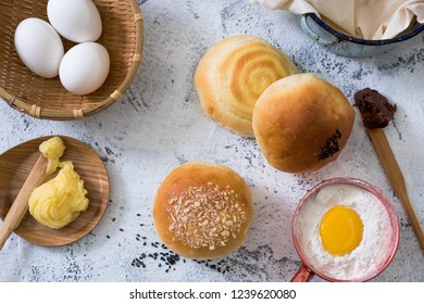 Traditional breads with ingredients on bright background
