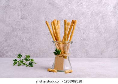 Traditional breadsticks with salt and parsley. Selective focus.