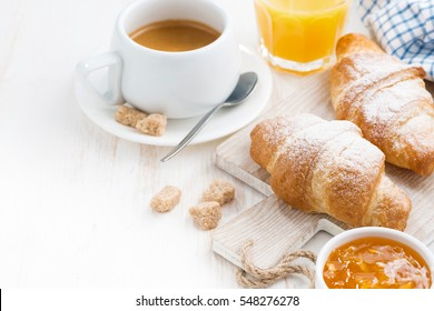 traditional breakfast with fresh croissants, horizontal