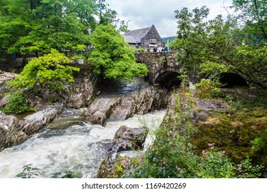 Traditional bridge and rapids of  Betws-y-Coed town in Snowdonia National Park in  Wales, UK