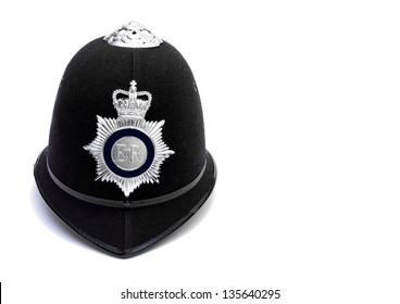 traditional british bobby police helmet on white