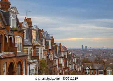 Traditional British brick houses on a cloudy morning with east London at background. Panoramic shot from Muswell Hill, England, UK