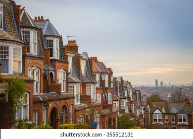 Traditional British brick houses on a cloudy morning with east London at background. Panoramic shot from Muswell Hill - England, UK