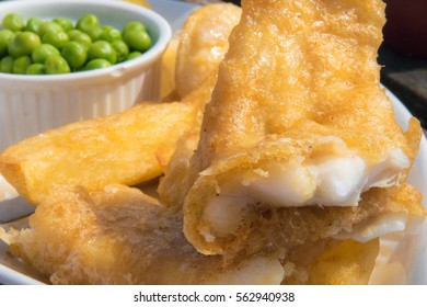 Traditional british fish and chips with peas, selective focus on the gorgeous crunchy batter