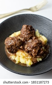 traditional British food meat faggots served with gravy and mashed potatoes