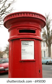 A traditional British postal box. Isolated with path
