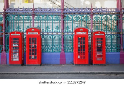 Traditional British red phone booths in a row on London street around Smithfield market