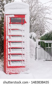 Traditional British red phonebooth covered in snow. Wales, UK, December