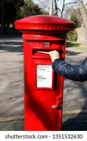 Traditional British red post box, also called pillar box. This free-standing type post box is found in the UK and members of the Commonwealth of Nations.