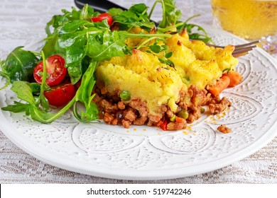 Traditional british shepard pie on plate with salad