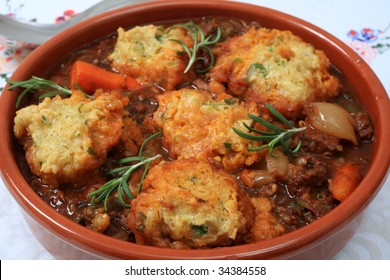 A traditional British stew, topped with parsley dumplings and garnished with rosemary.