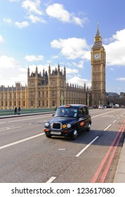 Traditional british taxi on Westminster bridge in London, UK