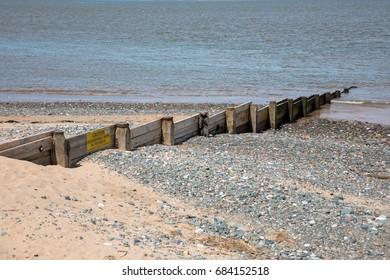 Traditional British wooden beach groyne, Lancashire, UK