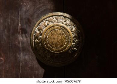 Traditional bronze door handle on a wooden door in Mdina, Malta