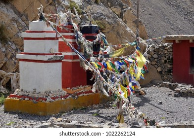 Traditional Buddhist chortens stand in the Himalayan mountains in the place of worship of the gods, with garlands of flags. Upper Mustang. Nepal.