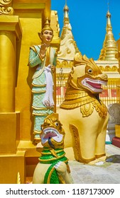 Traditional Buddhist sculptures of Nat Spirit and Chinthe leogryphs at the stupa in Shwedagon Zedi Daw, Yangon, Myanmar.