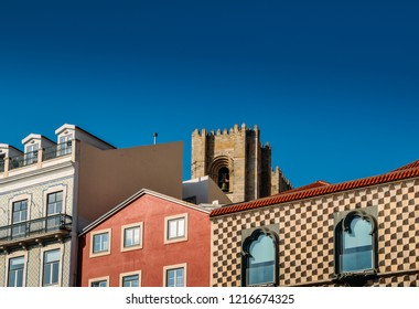 Traditional buildings with azulejo tiles in the old Lisbon neighbourhood of Alfama with Se cathedral in background, Portugal