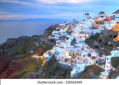 Traditional buildings of Oia village at nightfall, Santorini island, Greece