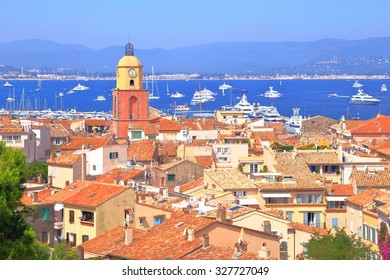 Traditional buildings and tall church tower near the Mediterranean sea, Saint Tropez, French Riviera, France