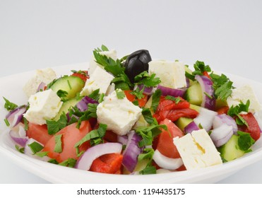 Traditional Bulgarian cuisine - Shopska salad with vegetables and cheese. Closup, background.