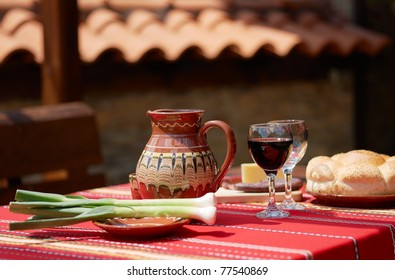 Traditional Bulgarian food wine, saussage, yellow cheese and garlic