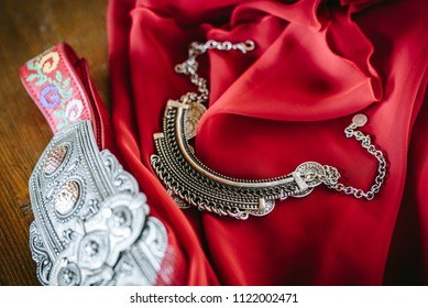 Traditional Bulgarian necklace and accessoires on a red scarf. Traditional Bulgarian wedding