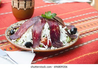 Traditional Bulgarian salad served in a traditional restaurant - mehana