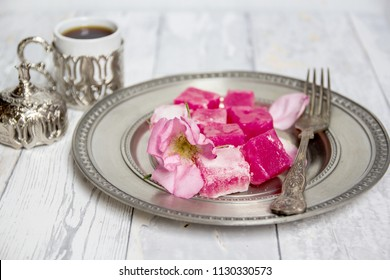 traditional bulgarian sweets - rose lokum and a cup of turkish coffee