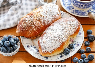 Traditional buns with blueberry filling.