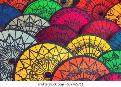 Traditional Burmese umbrellas. Colorful umbrellas at traditional street market in Bagan, Myanmar (Burma).Colored Burmese Umbrellas.Beautiful multi-colored background from Burmese umbrellas.