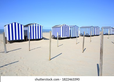 Traditional cabanas on the sand beach in De Panne, West Flanders, Belgium