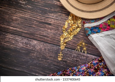Traditional Camisole of the handmade peasant woman of Panama, with her gold jewelry and panama hat